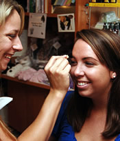 Alicia Scott shows a customer how to recreate her eyebrows.