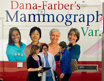 people talking outside the Mammography Van