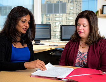 Sapna Syngal, MD, MPH (left) creates screening and prevention plans for individuals with inherited genetic mutations.