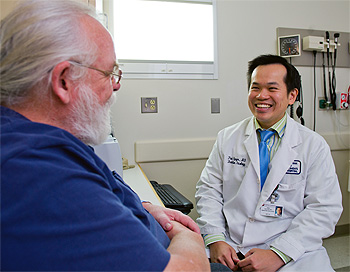 Dr. Paul Nguyen with a patient