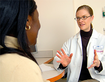 Nutritionist Stephanie Meyers, MS, RD, RDN, consults with a patient about her diet.