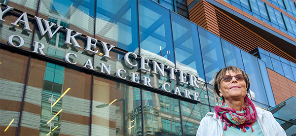 international patient in front of Dana-Farber's Yawkey Center for Cancer Care