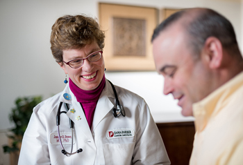 Jennifer Brown, MD, PhD with a patient