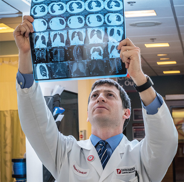 Matthew Davids, MD, examines a scan of a cancer patient.