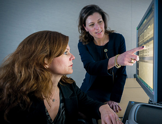 Ann Partridge, MD, MPH (left), and Tari King, MD, review the treatment plan for a breast cancer patient.