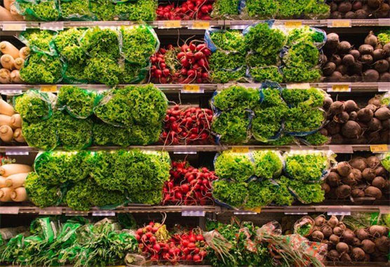 fresh produce on grocery store shelves