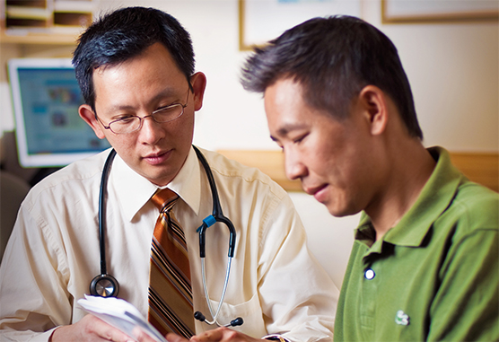 Vincent Ho, MD, with a patient
