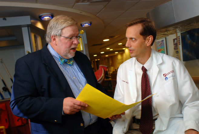 Holcombe E. Grier, MD, and Lewis B. Silverman, MD