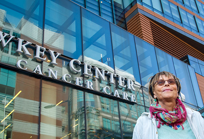 international patient in front of the Yawkey Center for Cancer Care