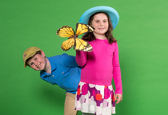 two children modeling gift shop items