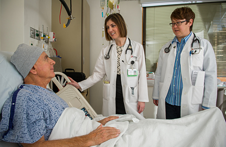 patient and caretakers in an inpatient room