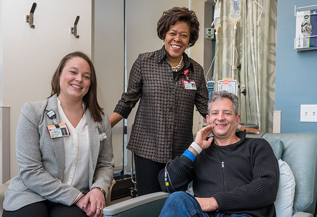 Nurses Jessica Setterstrom and Kecia Boyd with a patient