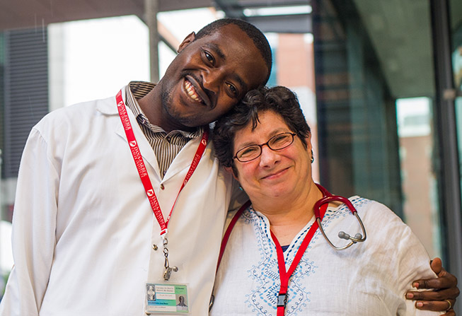 nurse from Rwanda and a nurse from Dana-Farber