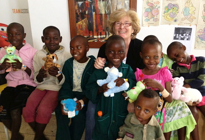 Lori Buswell with children in Rwanda