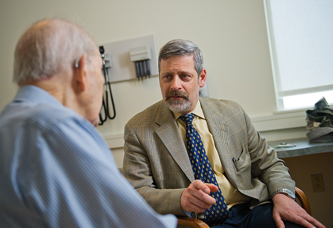 David Fisher, MD, with a patient