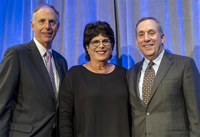 DFS Co-Chairs and Institute Trustees Jim and Barbara Sadowsky with Larry S. Bacow (right)