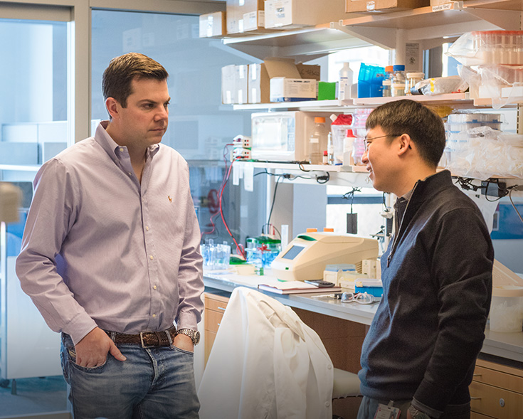 two Chemical Biology Program staff members talking in lab
